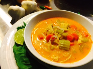 Shirataki Noodles Recipe Thai Curry Chicken Soup in bowl with squeeze of lime, garlic, and thai chilies